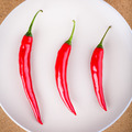 Three fresh chili peppers on plate - PhotoDune Item for Sale