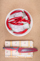 Fresh chili peppers with ice on plate - PhotoDune Item for Sale
