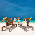 Couple in white running on a beach at Maldives - PhotoDune Item for Sale