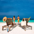 Couple in yellow on a beach at Maldives - PhotoDune Item for Sale