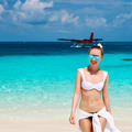 Woman at beach. Seaplane at background. - PhotoDune Item for Sale