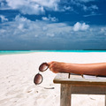 Woman at beach holding sunglasses - PhotoDune Item for Sale