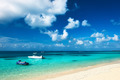 Beautiful island beach with motor boat - PhotoDune Item for Sale
