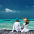 Couple on a beach jetty at Maldives - PhotoDune Item for Sale