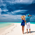 Couple in blue on a beach at Maldives - PhotoDune Item for Sale
