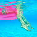 Woman relaxing on inflatable mattress, view from underwater - PhotoDune Item for Sale