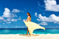 Woman with sarong at beach - PhotoDune Item for Sale