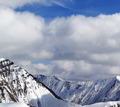 Winter snowy mountains in clouds at nice day - PhotoDune Item for Sale