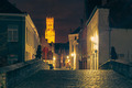 Cityscape with a picturesque night street and tower Belfort in Bruges - PhotoDune Item for Sale