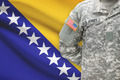 American soldier with flag on background - Bosnia and Herzegovina - PhotoDune Item for Sale