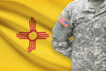 American soldier with US state flag on background - New Mexico - PhotoDune Item for Sale