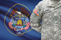 American soldier with US state flag on background - Utah - PhotoDune Item for Sale