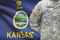 American soldier with US state flag on background - Kansas - PhotoDune Item for Sale