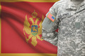 American soldier with flag on background - Montenegro - PhotoDune Item for Sale