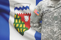 American soldier with Canadian province flag on background - Northwest Territories - PhotoDune Item for Sale