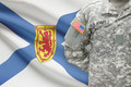 American soldier with Canadian province flag on background - Nova Scotia - PhotoDune Item for Sale