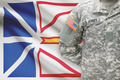 American soldier with Canadian province flag on background - Newfoundland and Labrador - PhotoDune Item for Sale
