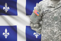 American soldier with Canadian province flag on background - Quebec - PhotoDune Item for Sale