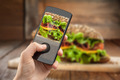 Hand taking photo of sandwich with smatphone - PhotoDune Item for Sale