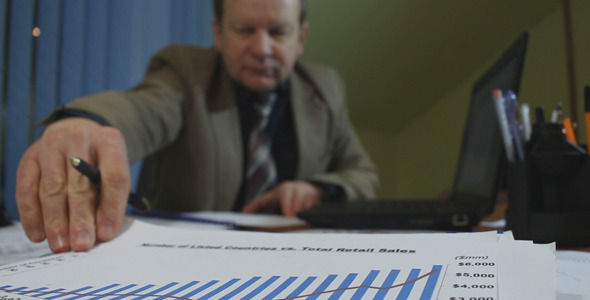 Businessman Working with Charts
