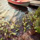 Boat at dock on small lake - PhotoDune Item for Sale