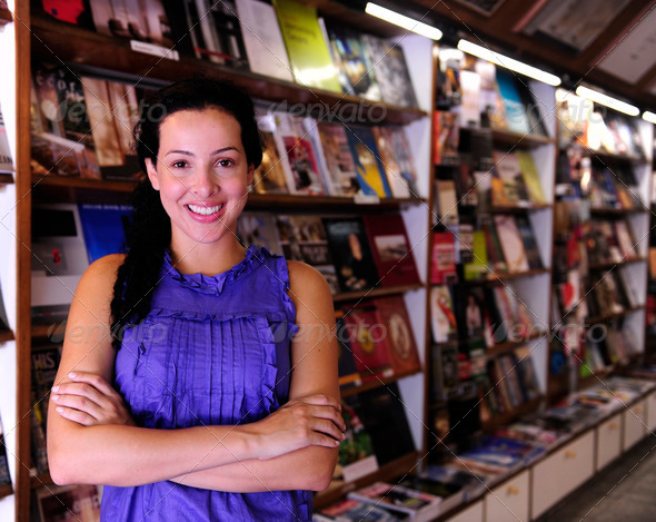 PhotoDune happy owner of a bookstore 1127574