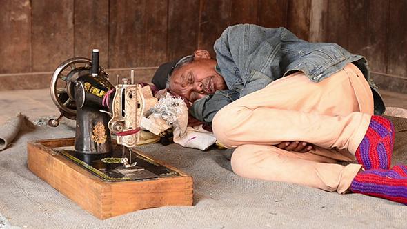 Seamstress Man Sleeping