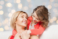 happy mother with daughter hugging and talking - PhotoDune Item for Sale