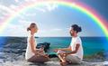 happy couple meditating in lotus pose on beach - PhotoDune Item for Sale
