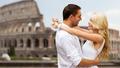 happy couple hugging over coliseum - PhotoDune Item for Sale