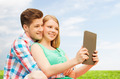 happy couple with tablet pc taking selfie outdoors - PhotoDune Item for Sale