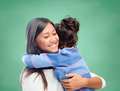happy woman and little girl hugging at school - PhotoDune Item for Sale