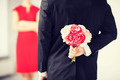 man hiding bouquet of flowers - PhotoDune Item for Sale