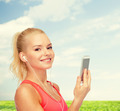 smiling sporty woman with smartphone and earphones - PhotoDune Item for Sale