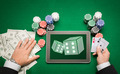casino poker player with cards, tablet and chips - PhotoDune Item for Sale