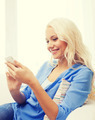 smiling woman with smartphone at home - PhotoDune Item for Sale