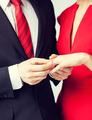 man putting  wedding ring on woman hand - PhotoDune Item for Sale