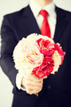 man giving bouquet of flowers - PhotoDune Item for Sale