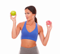 Latin woman in sport clothing looking confused - PhotoDune Item for Sale