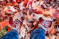 Feet standing in fallen maple leaves - PhotoDune Item for Sale