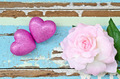 pink hearts and pink roses on grungy light blue wooden background - PhotoDune Item for Sale