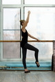 Young ballet dancer exercising at the barre in studio - PhotoDune Item for Sale
