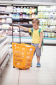 Little boy with big shopping cart in the store - PhotoDune Item for Sale