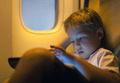 Little boy using tablet computer during flight - PhotoDune Item for Sale