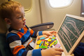 Boy in the plane drawing on board with chalk - PhotoDune Item for Sale