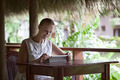 Smiling woman using tablet computer in cafe during vacation - PhotoDune Item for Sale