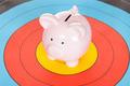 Piggy Bank Over Dartboard - PhotoDune Item for Sale