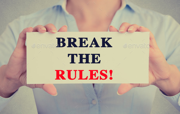 Closeup businesswoman hands holding retro sign break the rules message