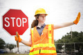 Female Construction Worker Directs Traffic - PhotoDune Item for Sale