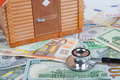 House model on money banknote with stethoscope - PhotoDune Item for Sale